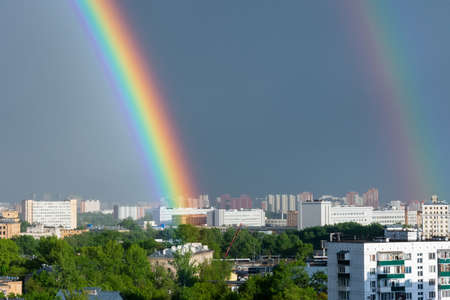Sunset and rainbow colors over town. Rainbow in Moscow 写真素材