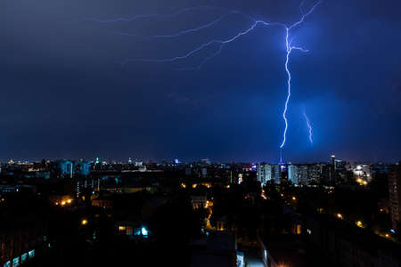 Lightning strike somewhere behind the block of flats in night Moscow