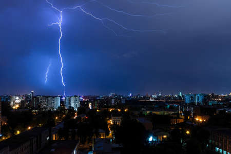 Lightning strike somewhere behind the block of flats in night Moscow Stock fotó