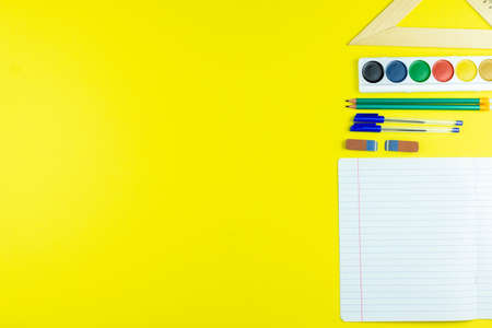 Back to school. School accessories on a yellow background. Фото со стока