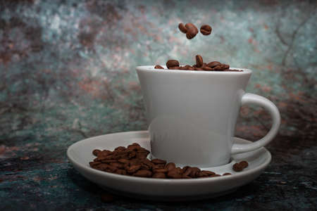 Coffee Cup and coffee beans on a marble background.