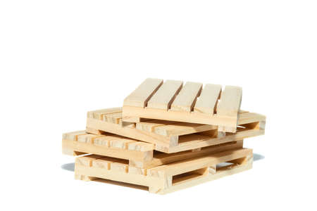 Stacked industrial wooden pallets for isolant cargo 免版税图像
