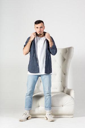 A man in a white t-shirt on a white background, Studio portrait 版權商用圖片
