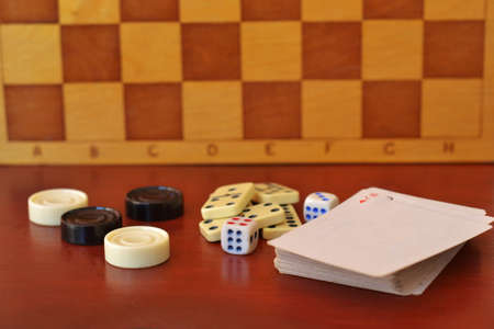 Various board games chess board, playing cards, dominoes. Hobby. Metaphor for games and gambling. Stock Photo