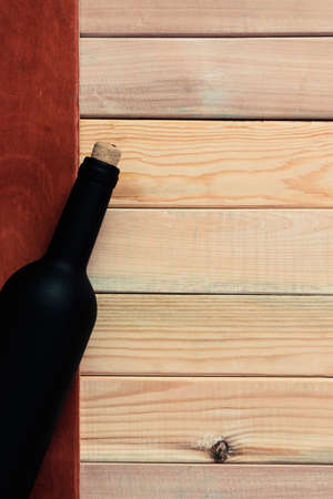 Bottle of red wine on a wooden table. Beautiful background