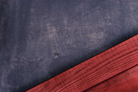 Work space new and red wooden background dark wall texture