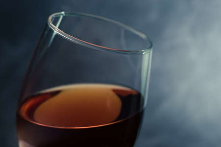 Glass of red wine close up. Beautiful dark background