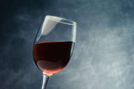 Glass of red wine close up. Beautiful dark background