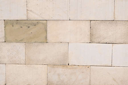 beige stone brick wall texture and pattern suitable for background and wallpaper Stock Photo