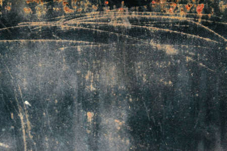scratched and rustic metal plate grungy texture and background pattern, suitable for wallpaper