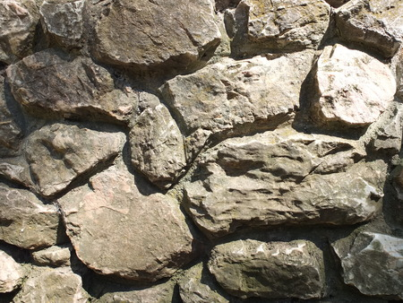 overbuilding: Stone wall  Stock Photo