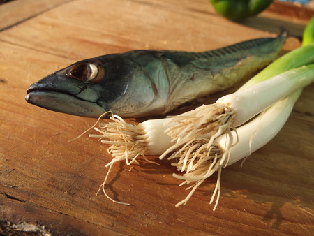 healthy snack: A healthy snack, smoked mackerel on wooden table.