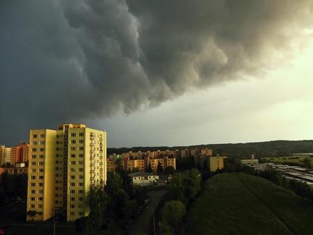 dark clouds: Storm over city in summer. Black clouds. Summer storm. Dark clouds. Stock Photo