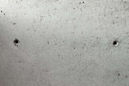 grunge background: rough concrete wall with cracks and dents, traces of formwork Standard-Bild