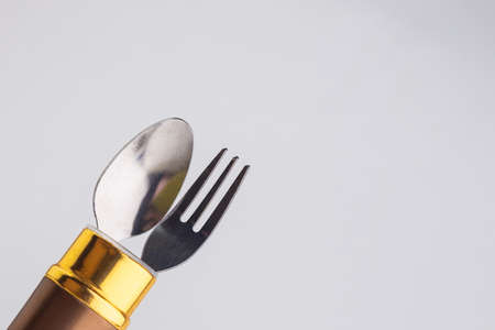 a set of dining items for camping: small spoon and fork, storage case