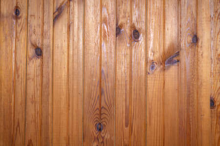grunge background: plank surface, varnished boards, yellow lights on top