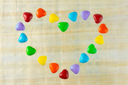 LGBT sweet flag: rainbow colored heart shaped caramels Stock Photo