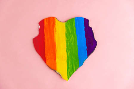 Concept - harassment of the freedom of the LGBT community: a burned and torn rainbow heart, short focus Reklamní fotografie