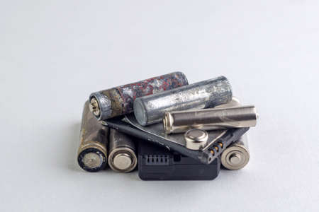 recycling of mercury and cadmium: several batteries are isolated on white, short focus, toning