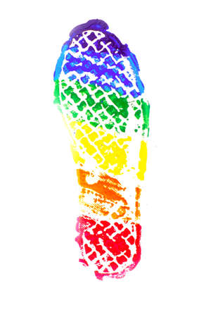 sign of sexual minority equality: a footprint painted in the colors of the flag of the LGBT community, isolated on white. short focus Stock Photo