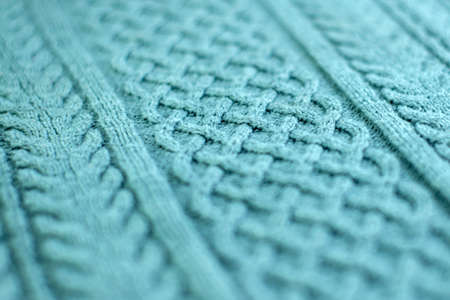 knitting and needlework: patterned knitted fabric, short focus