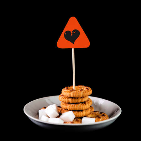 sweets harm concept: Sign of danger of heart attack over cookies and sugar Stock fotó