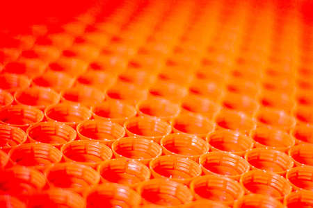 recycling plastic concept. red abstract background of plastic bottle caps, top view, short focus, enhanced contrast and color Standard-Bild