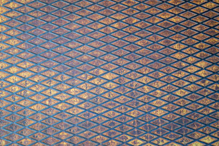 metal grunge background covered with abraded yellow paint, rust