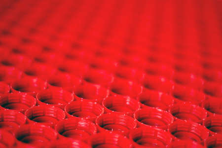 recycling plastic concept. red abstract background of plastic bottle caps, top view, short focus, enhanced contrast and color Stock fotó