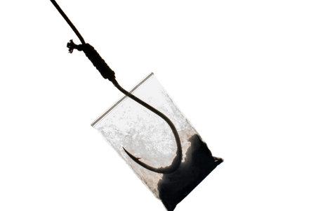drug trap concept: drug bag with fish hook inside
