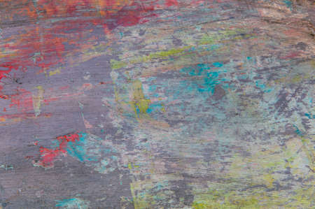 colorful creative motley background: smudged residues of oil paints on a wooden palette, short focus, selective blur