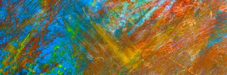 colorful creative motley background: smudged residues of oil paints on a wooden palette, short focus, selective blur Reklamní fotografie