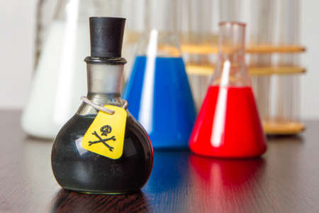 Russian Federation poisons concept: a bottle of poisonous material on the table against the background of Russian tricolor flasks Stock fotó