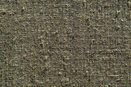 dark creative background: reverse side of black-primed linen canvas, uneven lighting, color toning
