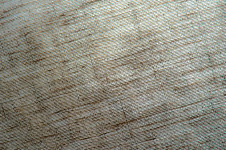 abstract rough colored linen natural fabric background, toning, short focus Foto de archivo