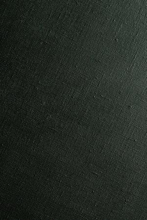 dark creative background: black primed linen canvas, uneven lighting, color toning Foto de archivo