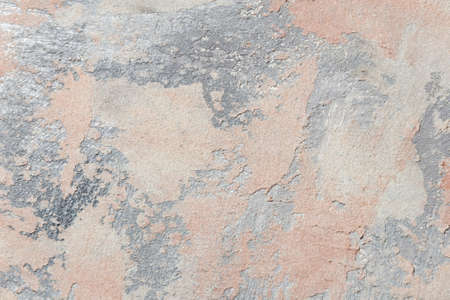 surface covered with decorative plaster with a chaotic pattern, multi-colored spots