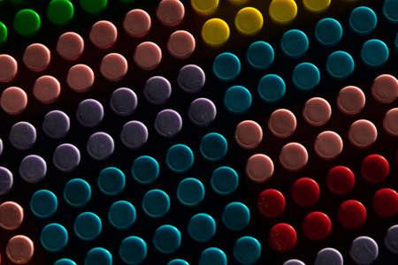 childish game background: darkened plane of plastic multi-colored bricks, blur, selective focus Foto de archivo