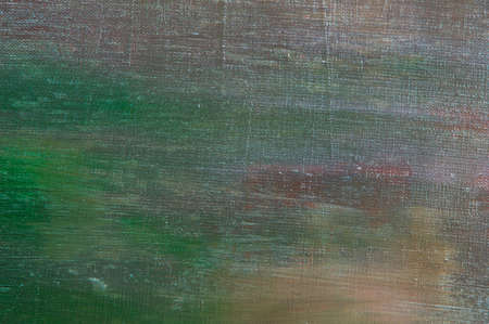 abstract colored creative background - rough linen canvas unevenly covered with multi-colored primers, reflections of light. Toning, blurring, selective focus. Temporary object.