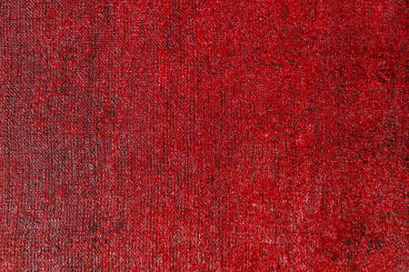 abstract creative background: red stain of colored primer when toning the canvas, temporary object.