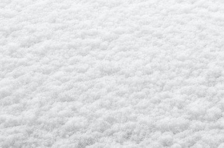 winter background: fresh clean even snow, large snowflakes Foto de archivo
