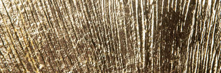 area of radially crumpled gold patina, flare effect, short focus