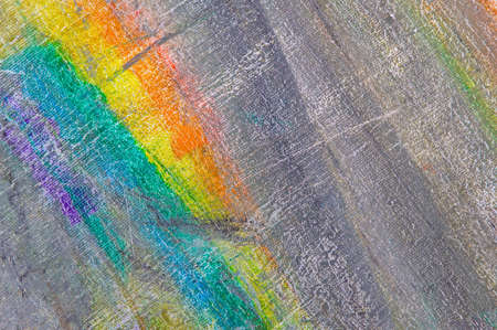 abstract rainbow multicolored background formed by erasing paints from the canvas, short focus. Not an art object, temporary effect. Foto de archivo