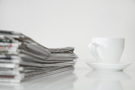 Reading newspaper on white background 스톡 콘텐츠