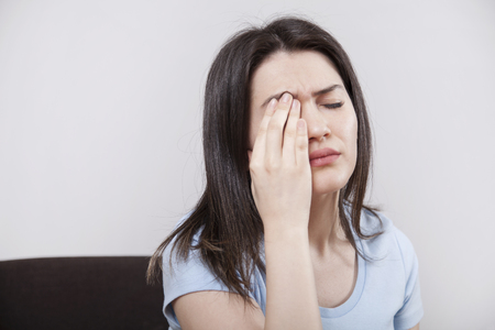 Young woman with eye fatigue Imagens