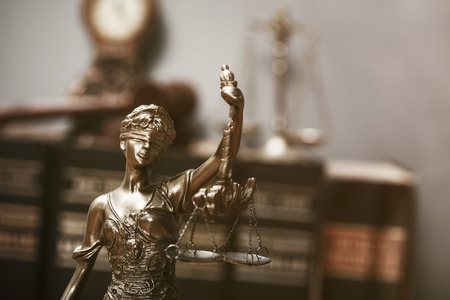 Justice blindfolded lady holding scales and sword statue Archivio Fotografico