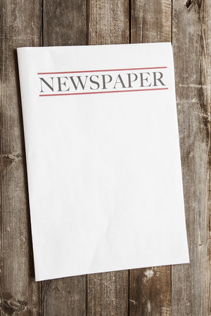 Newspaper on wooden background
