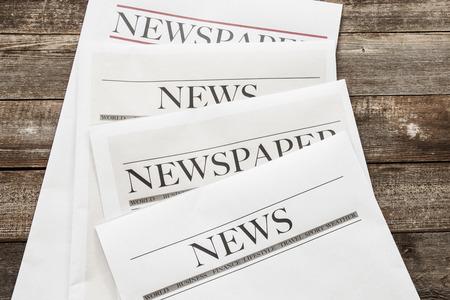 Newspaper on wooden background