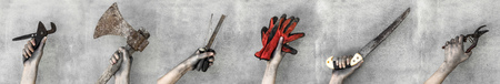 Hands holding working tools isolated on gray background