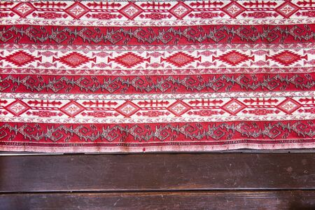 Colorful mosaic oriental kilim rug with traditional folk geometric ornament. Patterned carpet with a border frame Stockfoto